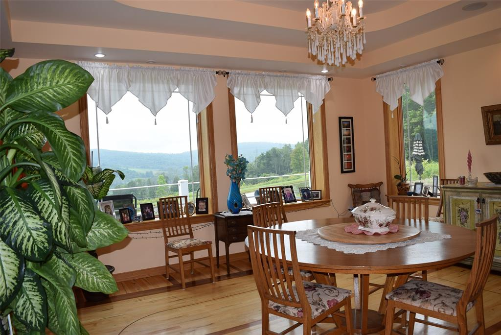 Custom Dining Room with Tray Ceiling and inlaid floors!