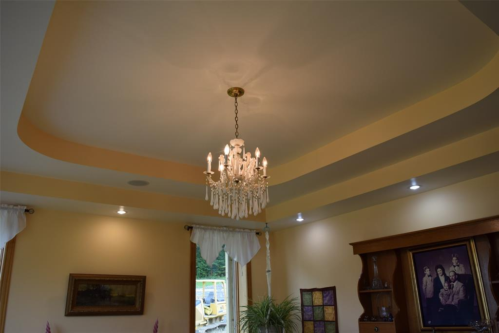 Custom Tray Ceiling and lovely chandelier!