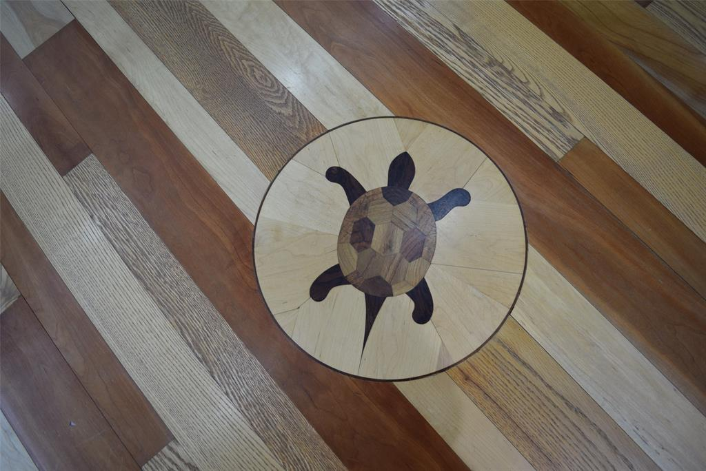 1 of several custom wood inlays in this home!