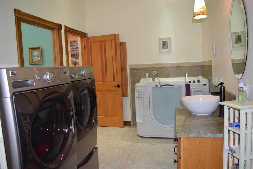 2nd Bedroom bathroom with laundry and a Senior Walk-In Tub!