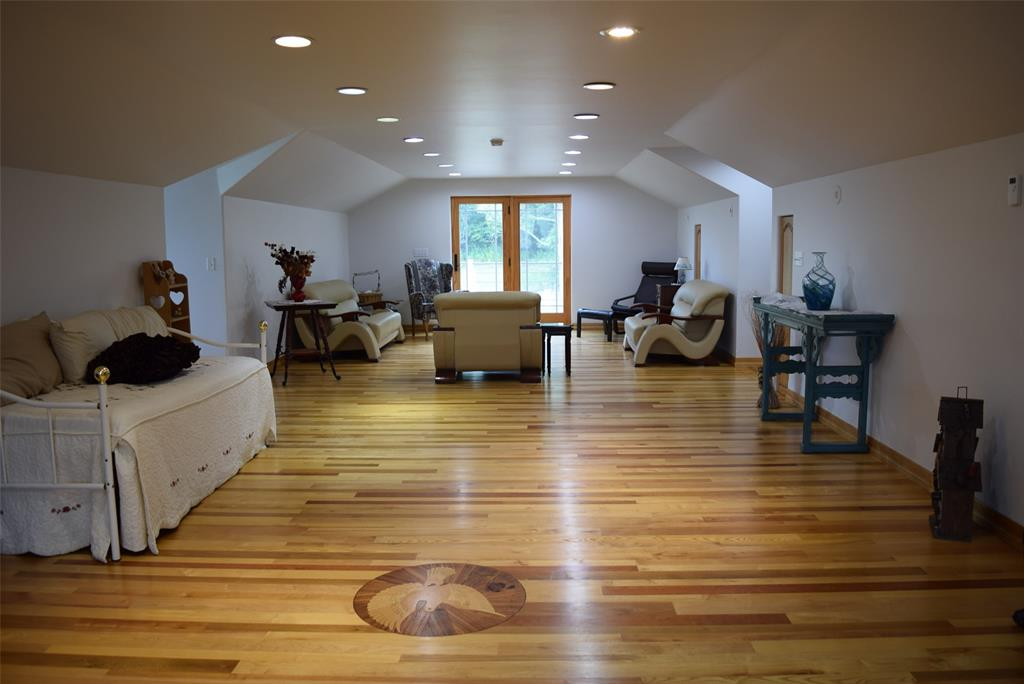View 2 of Gorgeous Great Room! Notice the Dove Wood Inlay on the floor!  French doors lead out to the brand new deck and steps!!