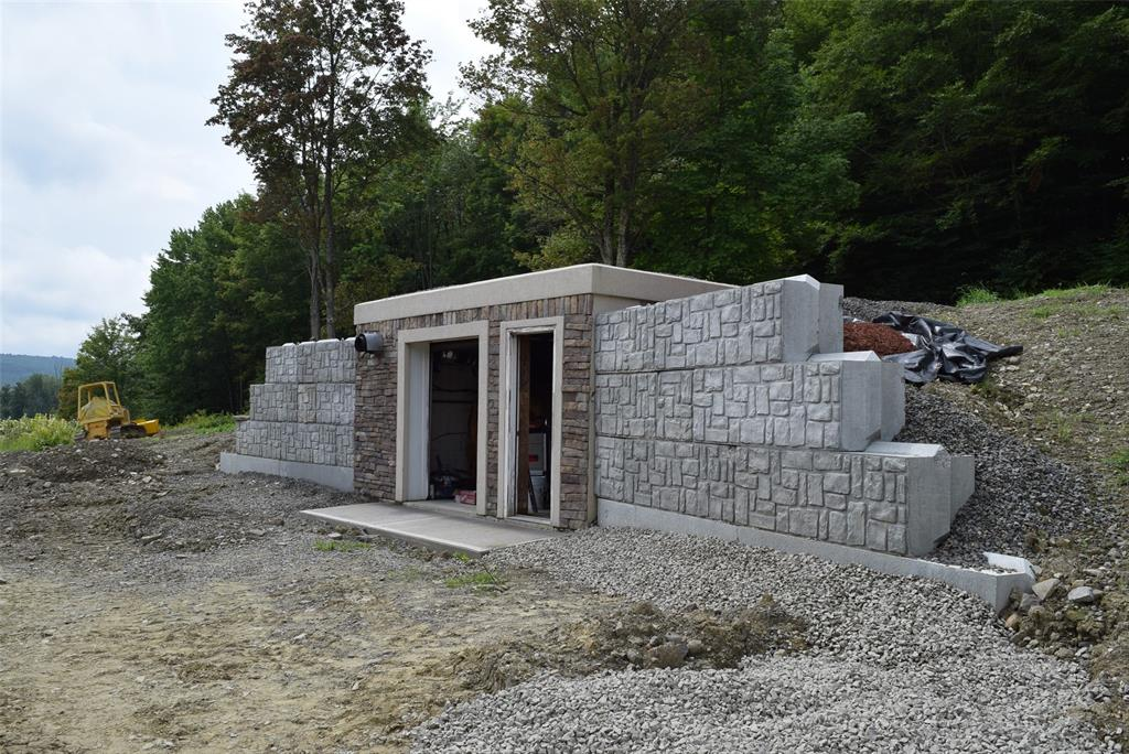 This 16X30 Bunker has a high efficiency wood boiler and 1,300 gallon of water storage. This can be converted back to Geothermal!