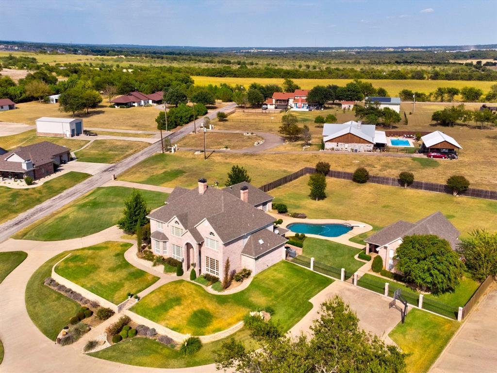 Imagine the calm serenity of this one owner custom built home on 2 acres with guest house and stunning lake views. Circular driv